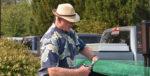Director Ron Davis cuts the ribbon at EPUD's EV Charger Dedication