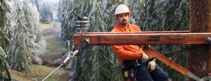 Meet Employee Jesse DuVal. Hie is high on a pole during the 2017 ice storm.