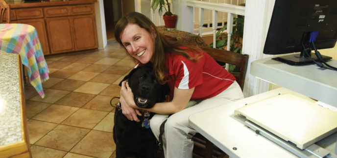 Sonja and her guide dog, Soto, at home.