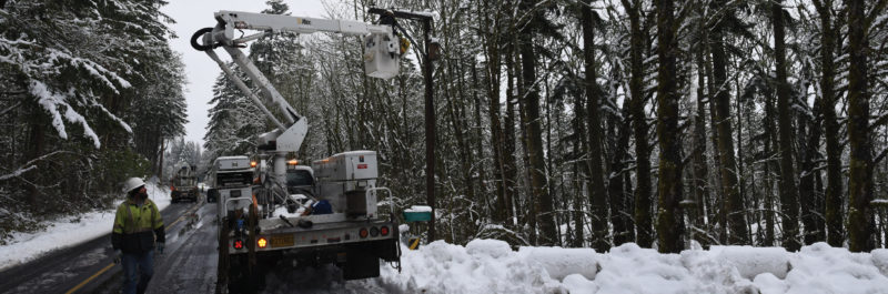 bucket truck on road during winter