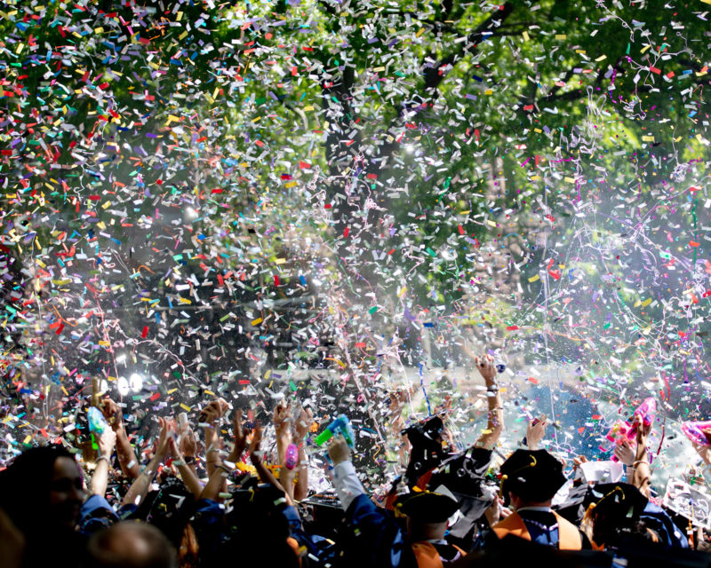 students graduating and confetti in the air around them