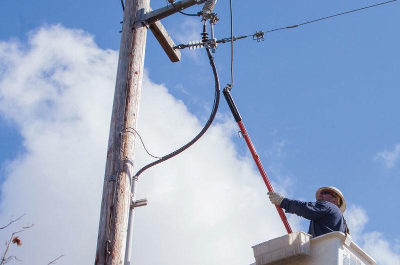 lineman in bucket truck working on power line
